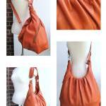Large orange convertible leather ba..