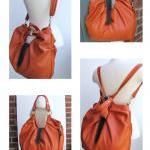 Large orange leather bag, pleated p..