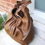 Large tan leather convertible backp..